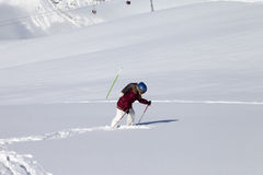Little skier on off-piste slope with new fallen snow at sun day Royalty Free Stock Photos