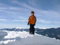 Little skier on a pile of snow Stock Photography