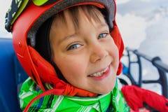 Little skier on ski lift Royalty Free Stock Image