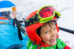 Little skier on ski lift Stock Photo