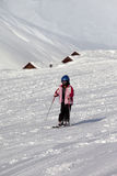 Little skier on ski slope at sun winter day Stock Photography