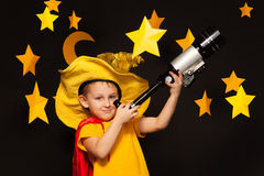 Little sky watcher looking through a telescope Royalty Free Stock Photography