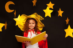 Little sky watcher studying stars with big book Royalty Free Stock Image