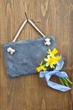 Little slate board and fresh daffodils Stock Photo