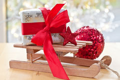 Little sledge with a gift box stock photo