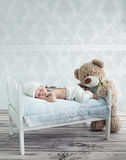 Little sleeping baby and the teddy bear Royalty Free Stock Image