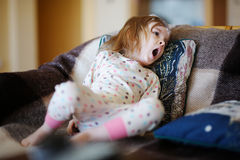 Little sleepy girl in pajamas Stock Photo