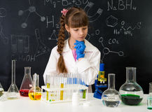 Little smarl girl in chemistry lab doing an experiment Royalty Free Stock Photo