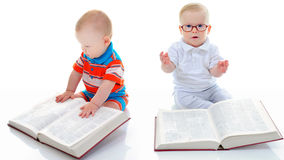 Little smart boy reads a big book. Stock Photo