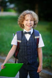 Little smart first grader in the school yard. Stock Photos
