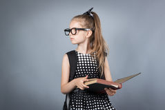 Little smart girl reading a book Stock Photo