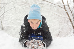 Little smile boy lie on snow royalty free stock photo