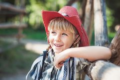 little smile cowboy girl on the ranch royalty free stock photography