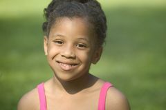 Little smile from a little girl Royalty Free Stock Images