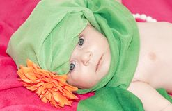 Little smiley baby girl on red blanket Royalty Free Stock Image