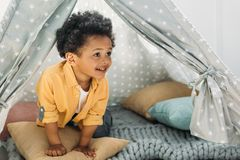 Little smiling african american boy in teepee. At home royalty free stock photo