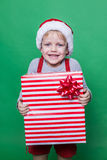 Little smiling Boy holding present box. Christmas concept Stock Photo
