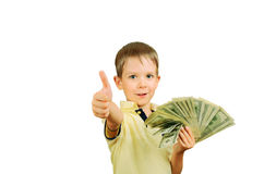 Little smiling boy holding a a stack of 100 US dollars bills and. Showing thumb up. isolated on white background. horisontal Royalty Free Stock Photography