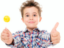 Little smiling boy shows thumb up Royalty Free Stock Images