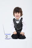Little smiling boy sits near portable radio with a Royalty Free Stock Image