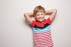 Little smiling boy in t-shirt isolated on white background. Studio portrait. Fashion royalty free stock photo