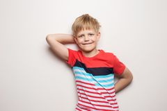 Little smiling boy in t-shirt isolated on white background. Studio portrait. Fashion stock photos
