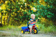 Little smiling boy on toy bicycle Royalty Free Stock Image