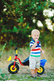 Little smiling boy on toy bicycle Royalty Free Stock Photos