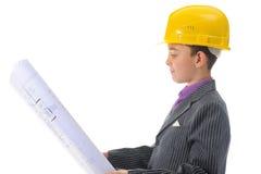 Little smiling builder in helmet royalty free stock photo
