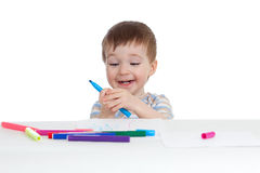 Little smiling child with color pen over white Stock Images