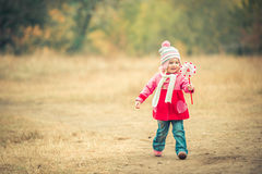 Little smiling girl on autumn landscape Stock Photography