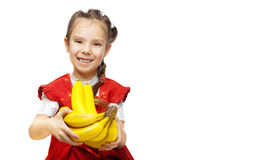 Little smiling girl with bananas Royalty Free Stock Photos