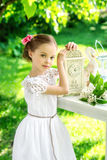 Little smiling girl with big clock. People, time management and Stock Photos