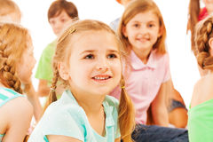 Little smiling girl with big smile and her friends Stock Photo