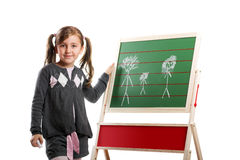 Little smiling girl on a board Royalty Free Stock Images