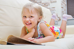 Little smiling girl with book Stock Image