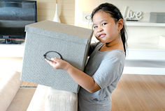 Little smiling girl with box. stock image