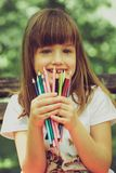 Girl is holding the crayons royalty free stock photos