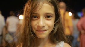 Little Smiling Girl Face Close Up. child laughs at night in the city. stock footage