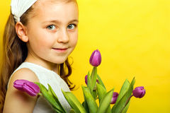 Little smiling girl with flowers Stock Photos