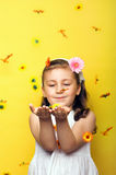Little smiling girl with flowers. Smiling beautiful young girl with falling flowers at spring Stock Photography