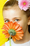 Little smiling girl with flowers Royalty Free Stock Photos