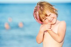 Little smiling girl in front of Red sea at sunset Stock Photography
