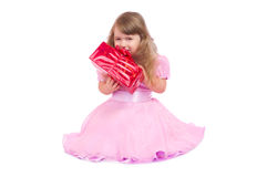 Little smiling girl with gift box Stock Image