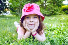 Little girl on the lawn royalty free stock photography