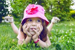 Little girl on the lawn royalty free stock image