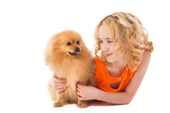 Little smiling girl holding her dog Stock Photography