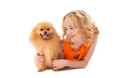 Little smiling girl holding her dog Royalty Free Stock Image