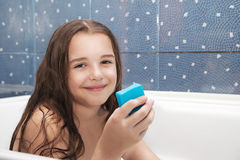 Little smiling girl holding soap Royalty Free Stock Photos