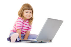 Little smiling girl with laptop Royalty Free Stock Photo